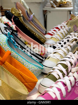 Storefront display of ladies casual foot ware - Stock Photo