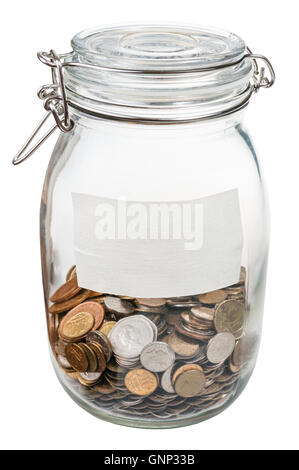closed glass jar with empty label and saved coins isolated on white background - Stock Photo