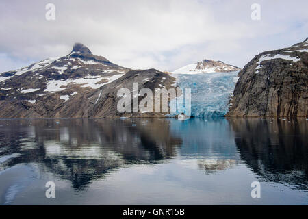 A glacier from the ice sheet calving into Prince Christian Sound / Prins Christians Sund in summer. Kujalleq Southern - Stock Photo