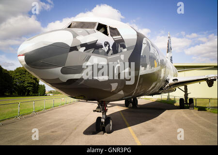 A retired civil airliner painted by art students as a project prior to dismantling - Stock Photo