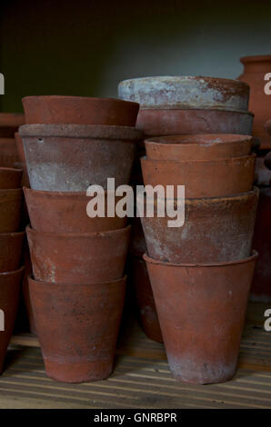 Stack of old clay flower pots - Stock Photo