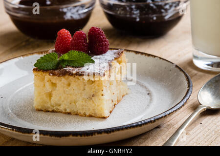 traditional homemade baked rice pudding with rasberry - Stock Photo