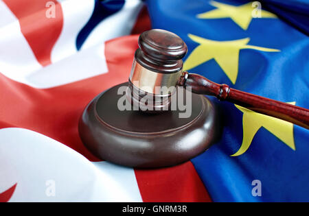 Gavel on top of British and European flags - Stock Photo