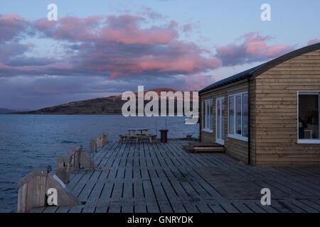 Tobermory, UK, coast of the Isle of Mull in Scotland in the evening sun - Stock Photo