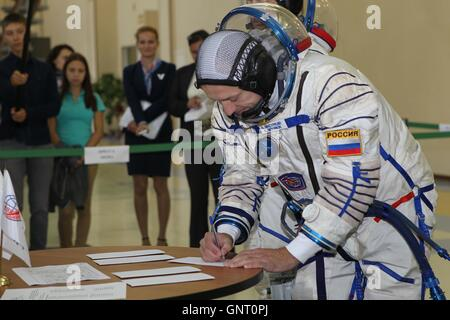 International Space Station Expedition 49-50 backup crew member Russian cosmonaut Alexander Misurkin signs in for - Stock Photo