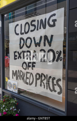 Shop Closing Down sign. Metaphor recession, economic slow-down, falling sales, competition, retail high street crisis - Stock Photo