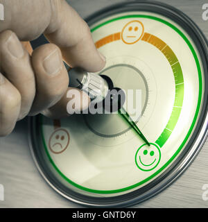 Close-up of a hand turning the knob of a customer feedback device to the highest position. Concept of good mood - Stock Photo