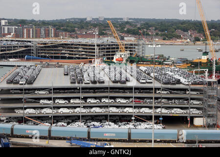Jaguar and Land Rover 4 x 4 vehicles in multi strorey car park awaiting export from Southampton docks - Stock Photo