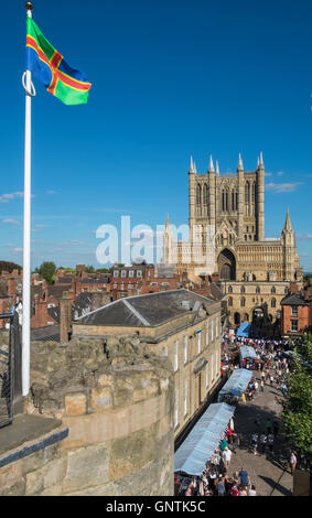 Historic City of Lincoln, UK, with Lincoln Cathedral in the background, and the county of Lincolnshire flag in the - Stock Photo