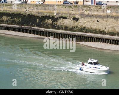 Entrance to inner harbour from Quai de la Marne, Dieppe, France with vessel Dieppe Snoop in foreground - Stock Photo