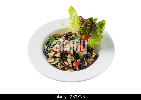 Front view of Italian and Thai fusion food style spicy black pasta with clams garnished with red chili and vegetables - Stock Photo