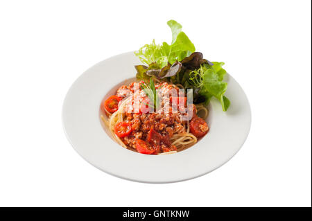 Front view of Italian style pasta red sauce with tomato and minced pork garnished with vegetables isolated on white - Stock Photo