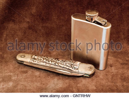 Pocket Knife and Hip Flask - Stock Photo