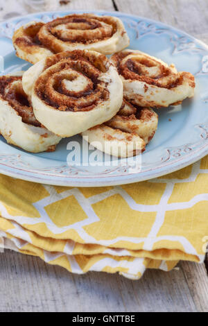 A plate of homemade cinnamon buns. - Stock Photo
