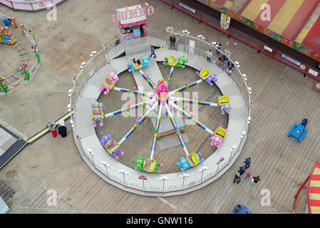 Clarence Pier funfair ride 'Dumbo' captured from the 'Portsmouth Eye' ferris wheel. - Stock Photo
