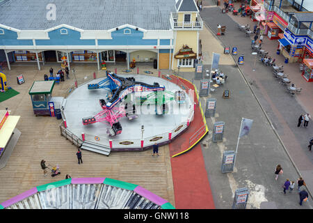 Clarence Pier funfair ride 'Twister' captured from the 'Portsmouth Eye' ferris wheel. - Stock Photo