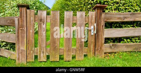 Wooden fence on a  garden - Stock Photo