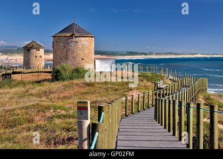 Portugal: Windmills and coastal path at beach Praia da Apúlia - Stock Photo