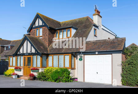 Large 1930s detached house in Mock Tudor style with double glazed windows in West Sussex, England, UK. - Stock Photo