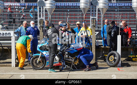 Michael Dunlop, race winner, in the pits having rear wheel changed during the Superbike Classic TT race 2016 - Stock Photo