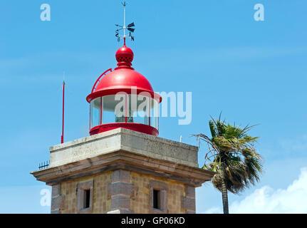 Lighthouse top on sky background (Ponta da Piedade cape, Lagos, Algarve, Portugal). - Stock Photo