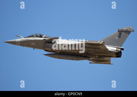 French Navy Dassault Rafale fighter jet flyby on a blue sky - Stock Photo