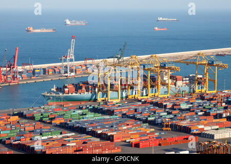 Ship being loaded in the container terminal from the Port of Barcelona. - Stock Photo