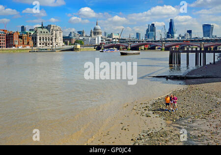 London, England, UK. River Thames at low tide - people on the beach - Stock Photo