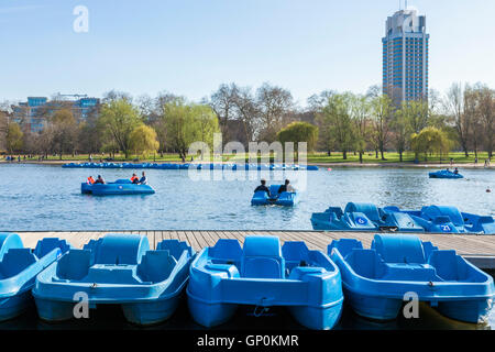 Pedal boats on the Serpentine, Hyde Park, London, England, UK - Stock Photo