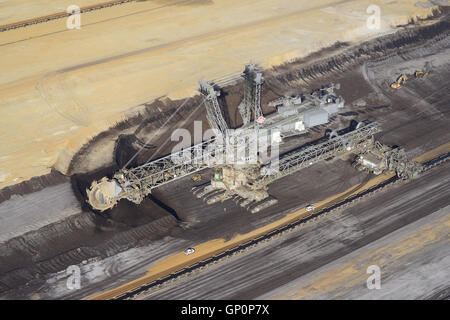 BUCKET-WHEEL EXCAVATOR WORKING A SEAM OF COAL (aerial view). Garzweiler Coal Mine, North Rhine-Westphalia, Germany. - Stock Photo