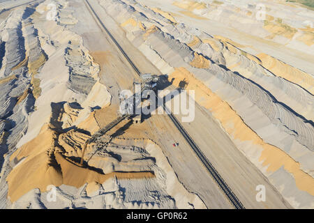 SPREADER DISPOSING OF THE OVERBURDEN (aerial view). Hambach Coal Mine, North Rhine-Westphalia, Germany. - Stock Photo