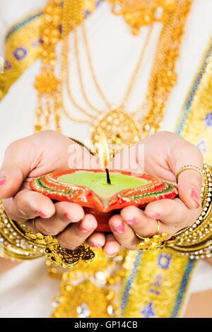 1 Beautiful Adult Bride Malayalee Woman Diwali Part-of Diya Hands-cupped Showing - Stock Photo