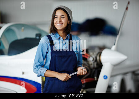 Cheerful young engineer in uniform - Stock Photo