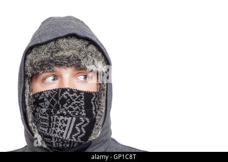 Blue-eyed boy wrapped in a hood like a ninja. Looking away. - Stock Photo