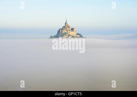 ABBEY ABOVE THE MORNING FOG (aerial view). Mont Saint-Michel, Manche, Normandy, France. - Stock Photo
