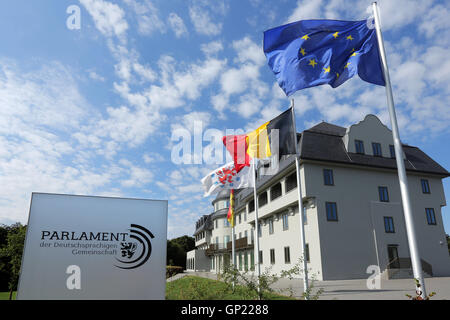 Parliament building of the German speaking Community in Eupen, Belgium. Flags from left to right: City of Eupen, - Stock Photo