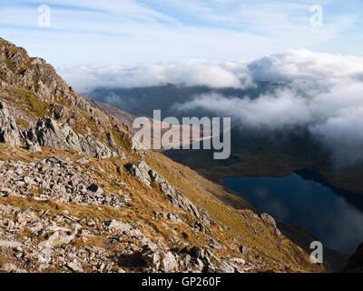 Cloud builds over Llyn Cau in Cwm Cau on Cadair Idris, Snowdonia National Park - Stock Photo