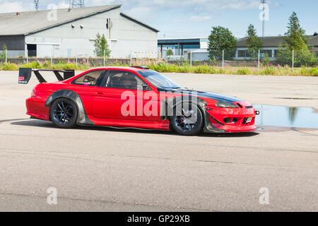 Kotka, Finland - July 16, 2016: Red custom Toyota sport car goes down the street - Stock Photo