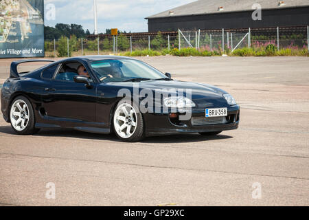 Kotka, Finland - July 16, 2016: Shining black Toyota Supra goes down the street in town - Stock Photo