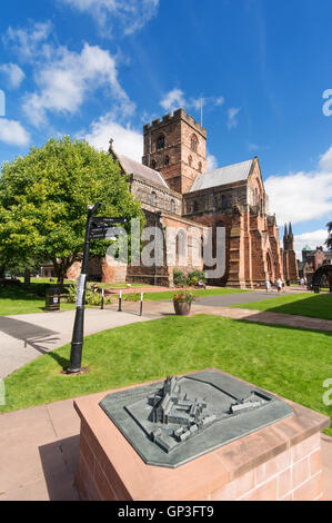 Carlisle cathedral with bronze model of the cathedral and abbey in the foreground, Cumbria, England, UK - Stock Photo