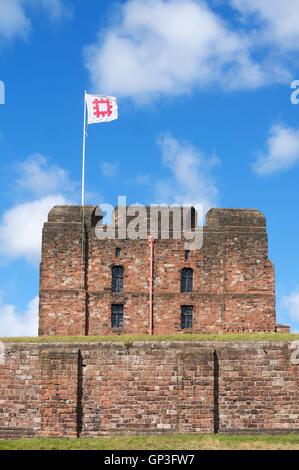 Carlisle castle keep with English Heritage flag flying, Cumbria, England, UK - Stock Photo