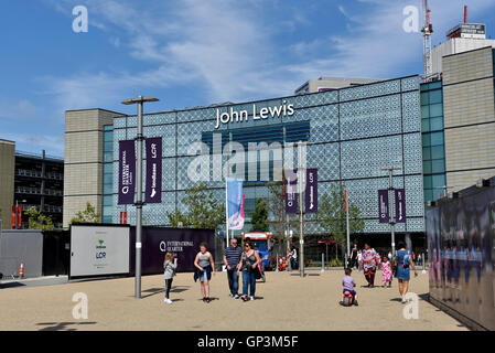 People John Lewis store seen from the rear with people walking in front, Westfield Stratford City, London England - Stock Photo