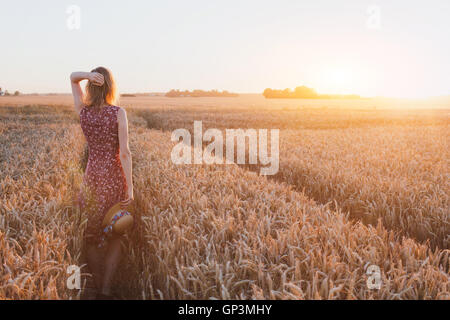 inspiration or waiting concept, happy beautiful young woman in sunset field, dream - Stock Photo