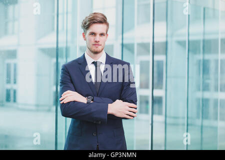 portrait of young successful businessman, career opportunity background - Stock Photo