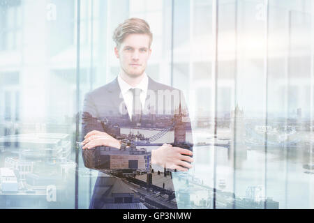 double exposure portrait of young successful business man and cityscape of London skyline - Stock Photo