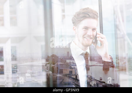 double exposure of business man talking by phone and London skyline panoramic view, cityscape - Stock Photo