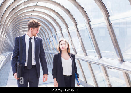 business people walking in office corridor interior - Stock Photo