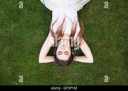 young woman enjoying music in headphones - Stock Photo