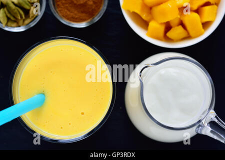 Mango lassi. Mango smoothie made with mango and yogurt, yoghurt. Selective focus. Top view. - Stock Photo