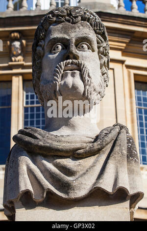 One of the Emperor Head sculptures situated outside the Sheldonian Theatre in the historic city of Oxford, England. - Stock Photo
